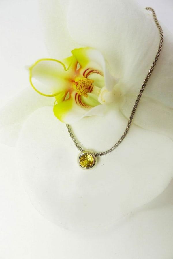 Yellow sapphire white gold pendant