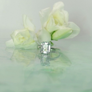Unique Emerald cut engagement ring