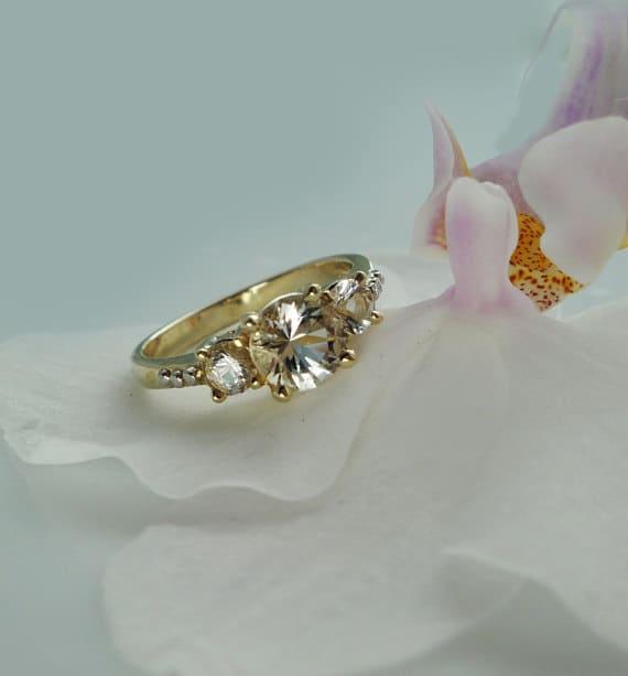 Three stone gold ring