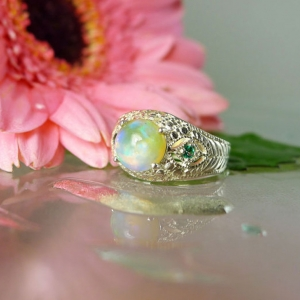 Opal ring emerald accents