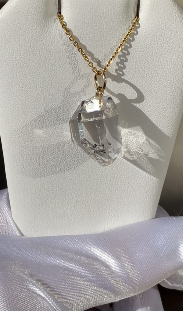 Raw crystal yellow gold pendant